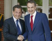 Zapatero y Sarkozy, dos caras de la misma moneda